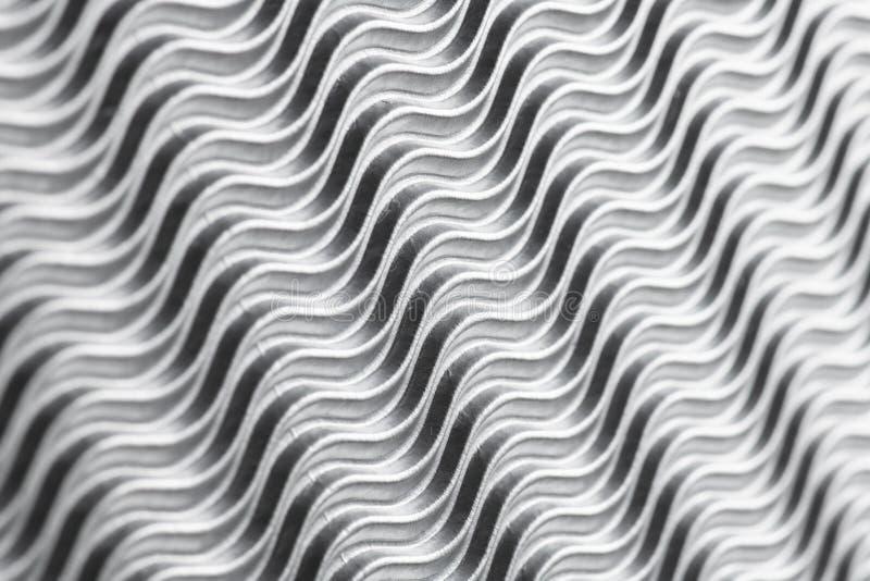 Fundo de prata bonito da estrutura das ondas ondas da sombra e de luz com espaço para o texto imagens de stock royalty free