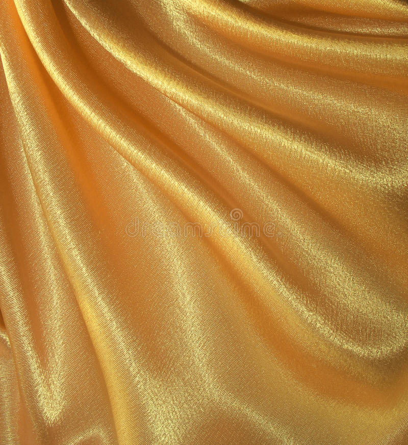 Fundo de seda dourado drapejado imagens de stock royalty free