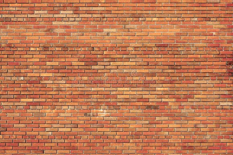 Fundo de uma parede de tijolo. imagens de stock
