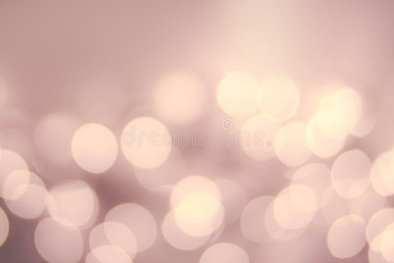 Fundo Defocused do vintage da luz de Bokeh do ouro do Natal Elegante foto de stock royalty free