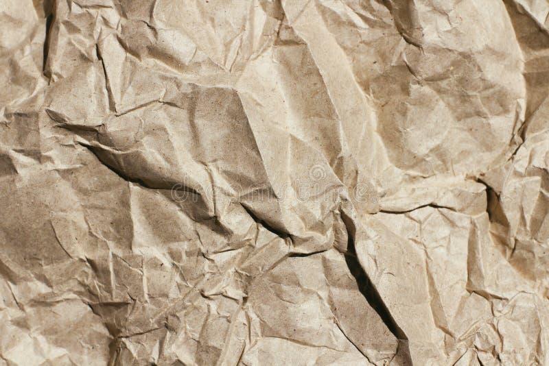 Fundo desintegrado da textura do papel da testa Vincos e riscos Molde velho da letra Papel do ofício para o pacote e os pacotes imagem de stock royalty free