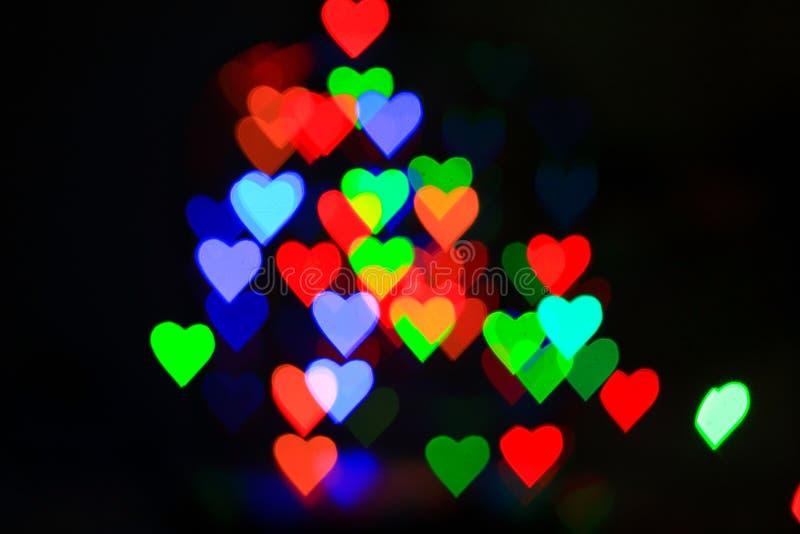 fundo do bokeh do ilght dos corações imagem de stock