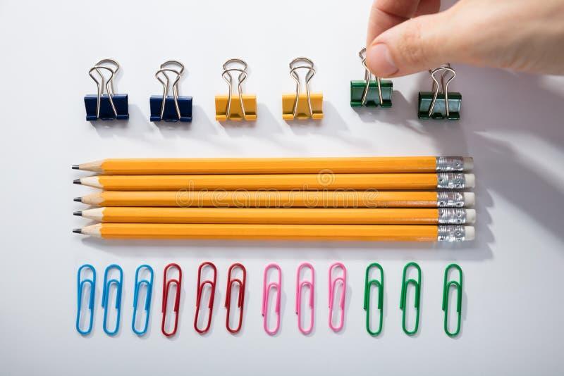 Fundo do branco de Person Arranging The Pencils On fotos de stock royalty free