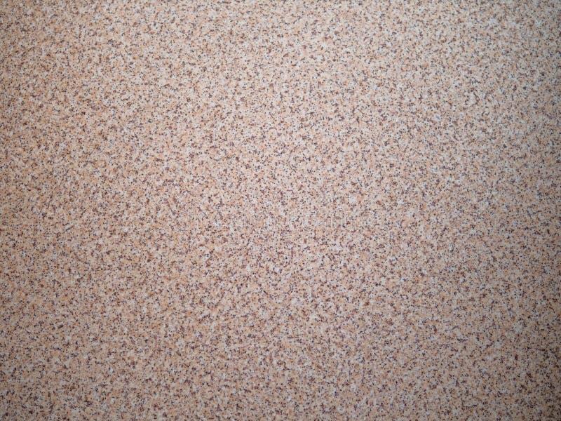 Fundo do cascalho dispersado da multa da areia Textura de uma superfície de pedra, close up Migalha dourada imagens de stock
