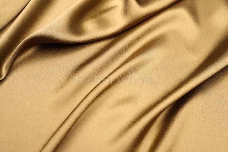 Fundo do cetim do ouro foto de stock