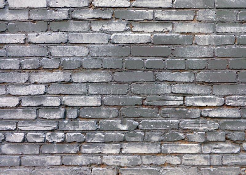 Fundo do grunge de Uurban da parede pintada cinzenta do tijolo velho fotografia de stock