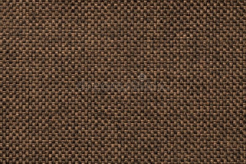 Fundo do marrom escuro da tela de ensaque tecida densa, close up Estrutura do macro de matéria têxtil imagens de stock