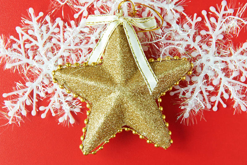 Fundo do Natal com estrela do ouro fotos de stock