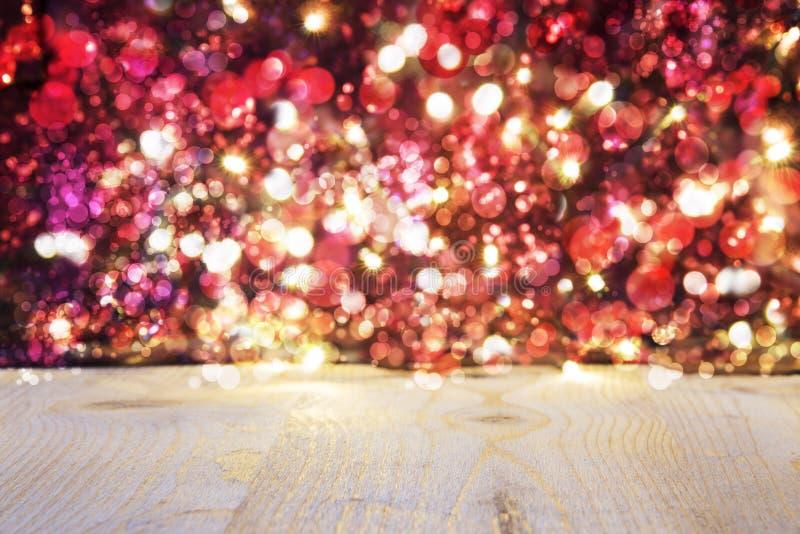 Fundo do Natal com luzes de incandescência brilhantes vermelhas imagem de stock
