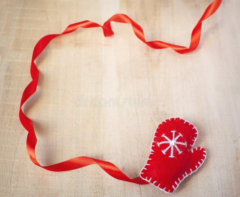 Fundo do Natal com o mitene do vermelho de Santa Claus imagem de stock