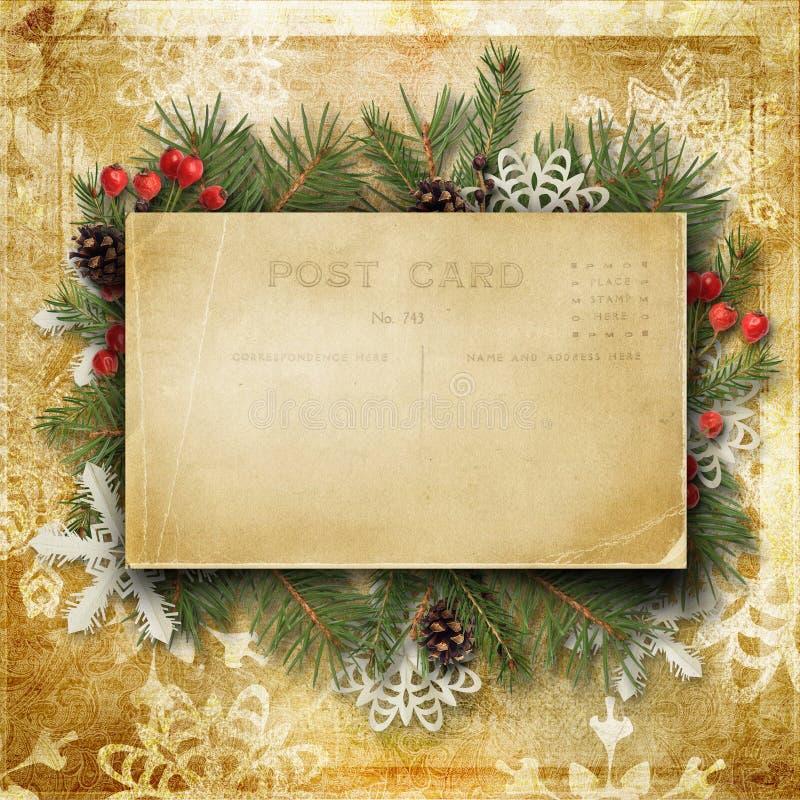 Fundo do Natal do vintage com cartão, ramos e o HOL velhos fotos de stock