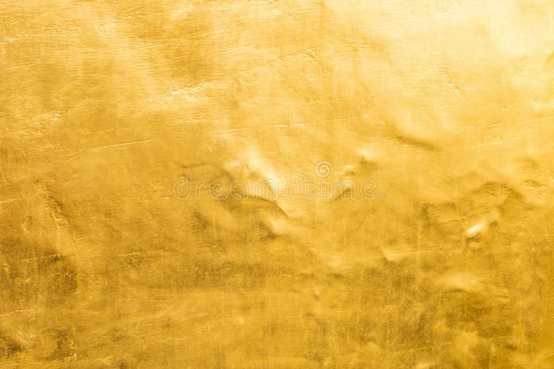 Fundo do ouro ou texturas e sombras, paredes velhas e riscos fotografia de stock royalty free