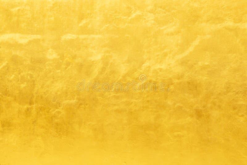 Fundo do ouro ou texturas e sombras, paredes velhas e riscos fotos de stock
