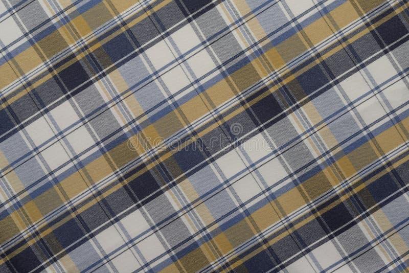 Fundo do pano azul, amarelo e branco da manta imagem de stock
