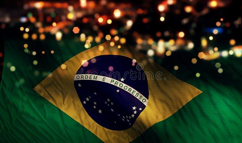 Fundo do sumário de Bokeh da noite da luz da bandeira nacional de Brasil fotografia de stock