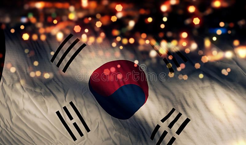 Fundo do sumário de Bokeh da noite da luz da bandeira nacional de Coreia do Sul fotografia de stock royalty free