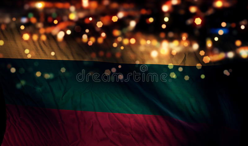 Fundo do sumário de Bokeh da noite da luz da bandeira nacional de Lituânia imagem de stock royalty free