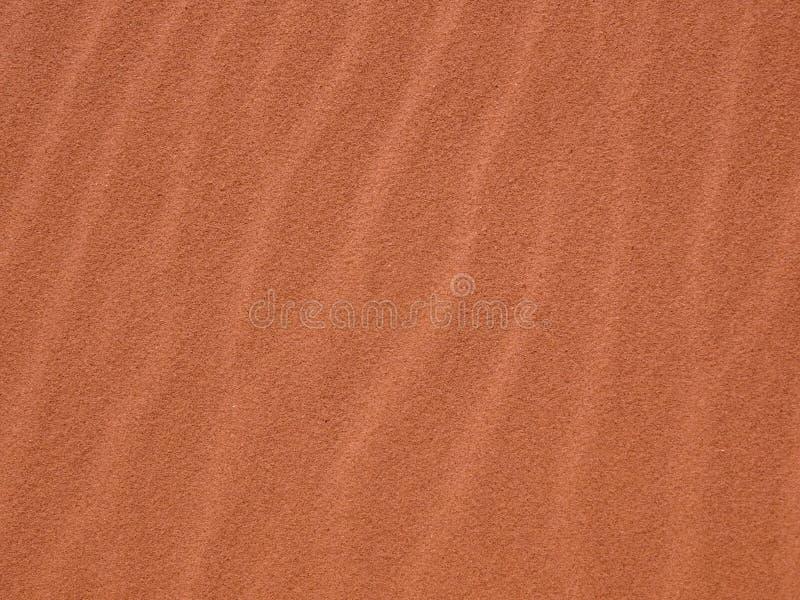 Fundo do teste padrão das ondinhas da areia fotos de stock