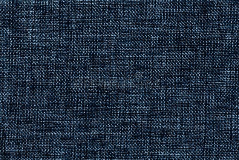 Fundo dos azuis marinhos da tela de ensaque tecida densa, close up Estrutura do macro de matéria têxtil imagens de stock