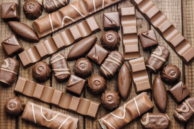 Fundo dos chocolates, das barras e dos doces, espaço livre para o texto fotos de stock royalty free