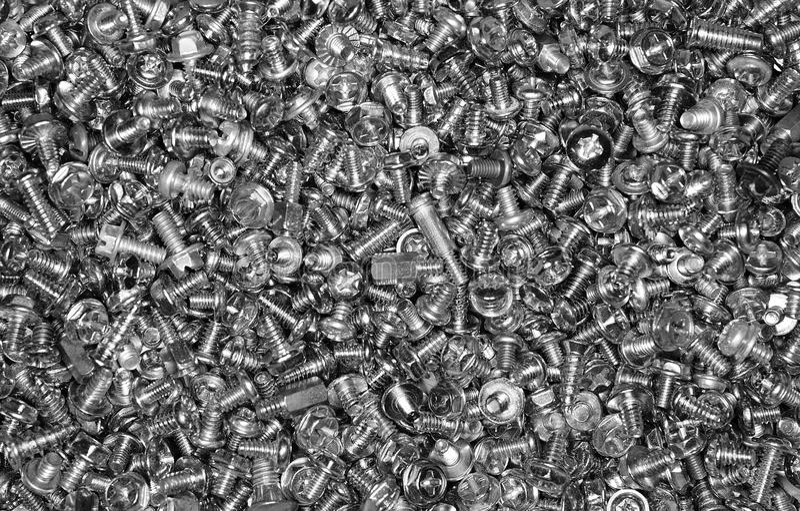 Fundo dos parafusos de metal foto de stock royalty free