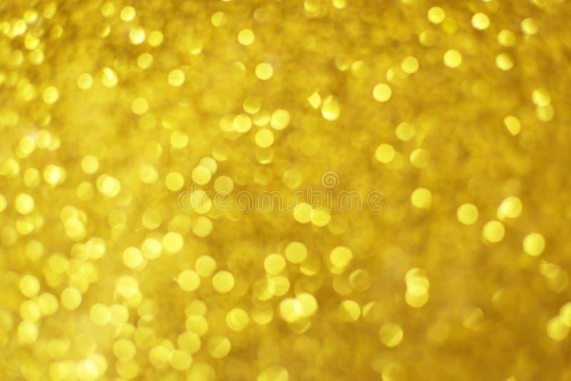 Fundo dourado abstrato do bokeh das luzes fotografia de stock