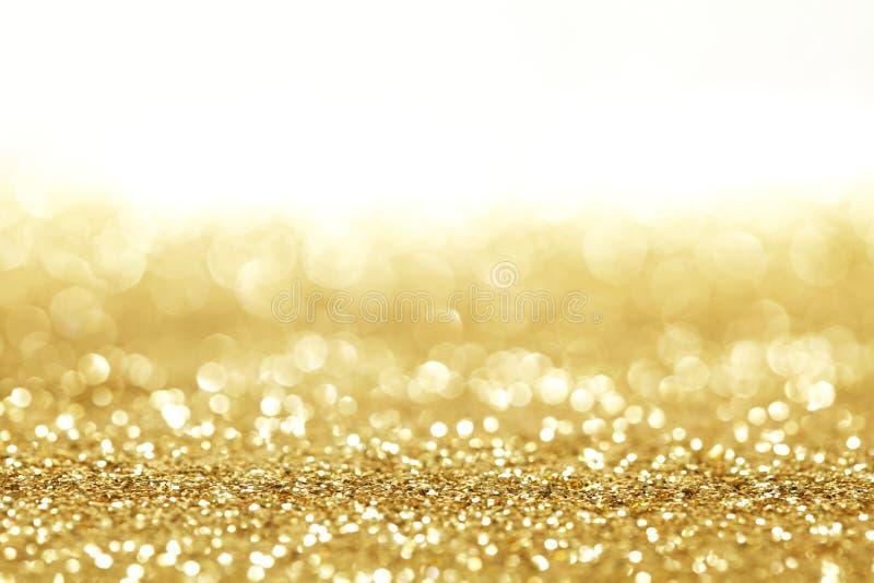 Fundo dourado do brilho fotos de stock royalty free
