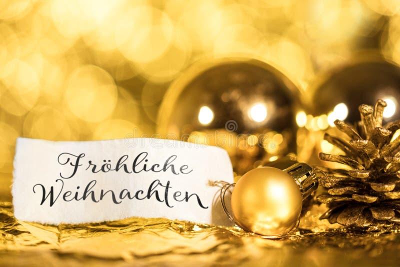Fundo dourado do Natal, etiqueta com texto alemão fotos de stock royalty free