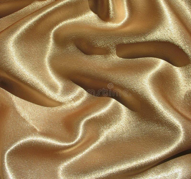 Fundo drapejado do cetim do ouro fotos de stock