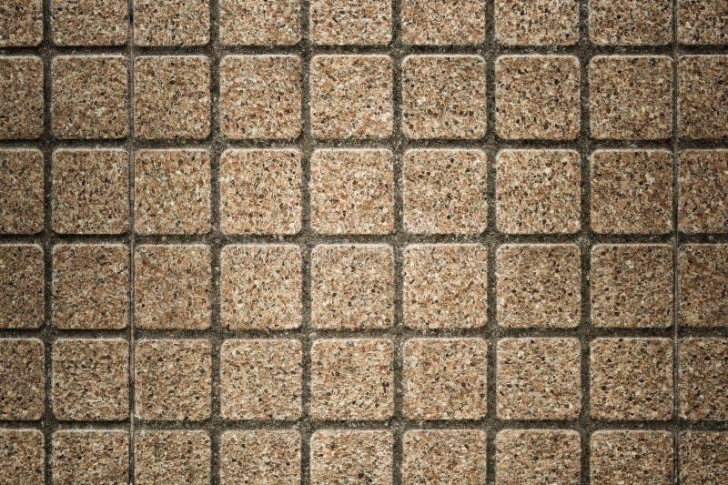 Fundo e textura de pedra exteriores da parede da telha do bloco quadrado imagens de stock