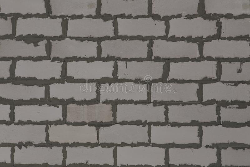 Fundo e textura Um close up acima da imagem do cimento cinzento dos tijolos brancos do aerocrete articula visível fotografia de stock royalty free