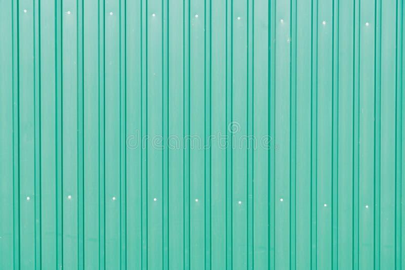 Fundo e textura verdes da parede do metal fotografia de stock