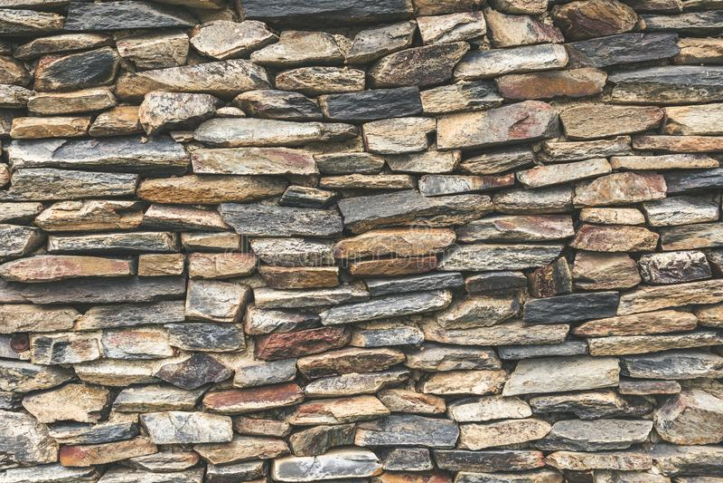 Fundo empilhado da parede de pedra fotografia de stock royalty free