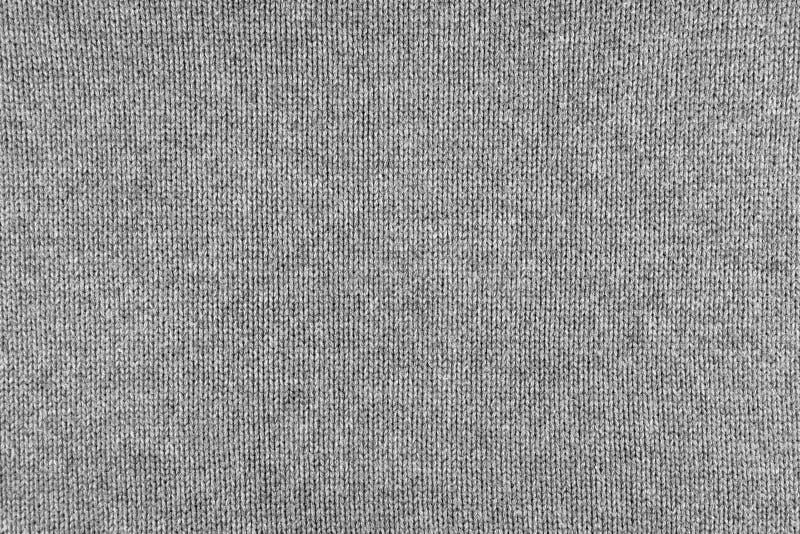 Fundo feito malha pano de lãs Cor cinzenta neutra de confecção de malhas da textura de lãs da tela imagem de stock royalty free