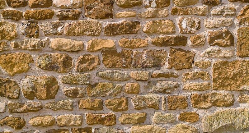 Fundo Honey-coloured da parede de pedra imagem de stock royalty free