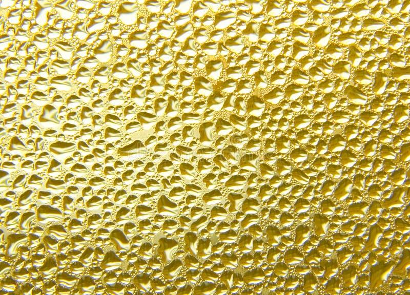Fundo líquido do ouro fotografia de stock