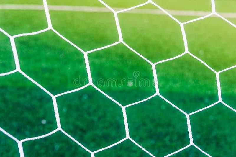 Fundo líquido sobre a grama verde do campo de futebol imagens de stock