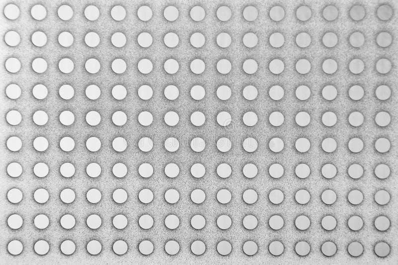 Fundo metálico perfurado de aço fotos de stock