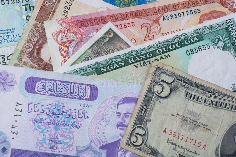 Fundo misturado das cédulas do dinheiro estrangeiro imagem de stock
