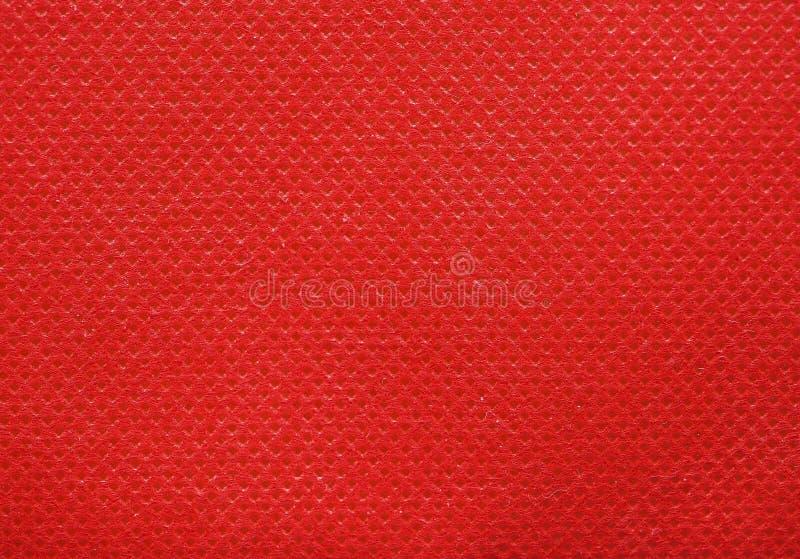 fundo não tecido vermelho da textura da tela do polipropileno fotos de stock