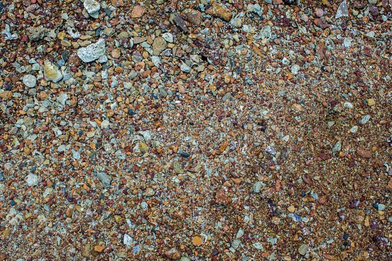 Fundo natural da textura da pedra da areia Areia na praia como o fundo Textura concreta do creme da arte para o fundo no preto imagens de stock