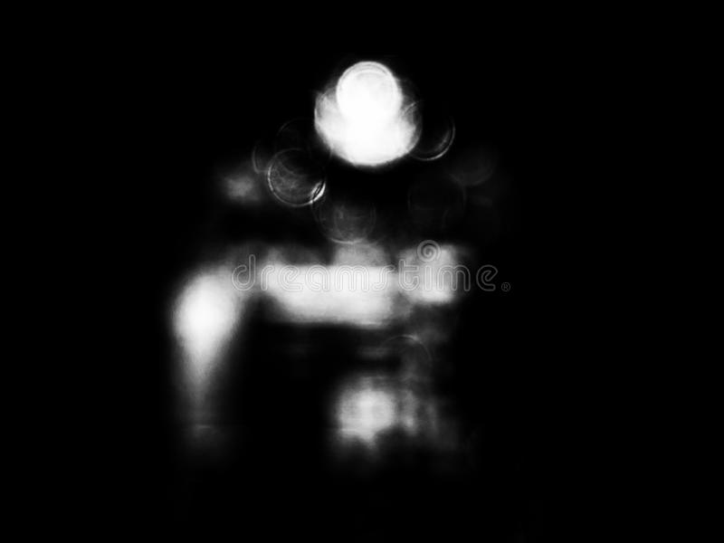 Fundo obscuro do bokeh em preto e branco fotografia de stock