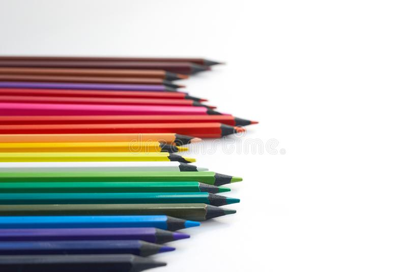 Fundo ou bandeira colorida com lugar para o texto, cópia-espaço Lápis da cor na esquerda em um fundo branco foto de stock royalty free