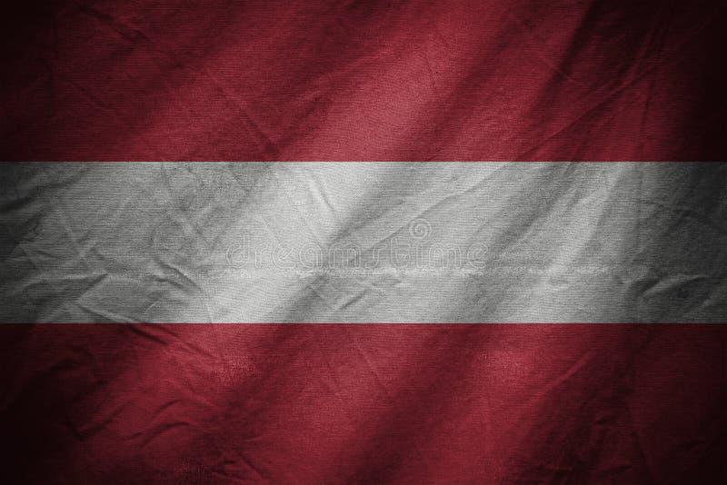 Fundo ou textura escura de matéria têxtil com mistura da bandeira de Áustria imagem de stock royalty free