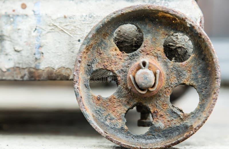 Fundo oxidado velho do detalhe do close up da roda do metal fotografia de stock royalty free