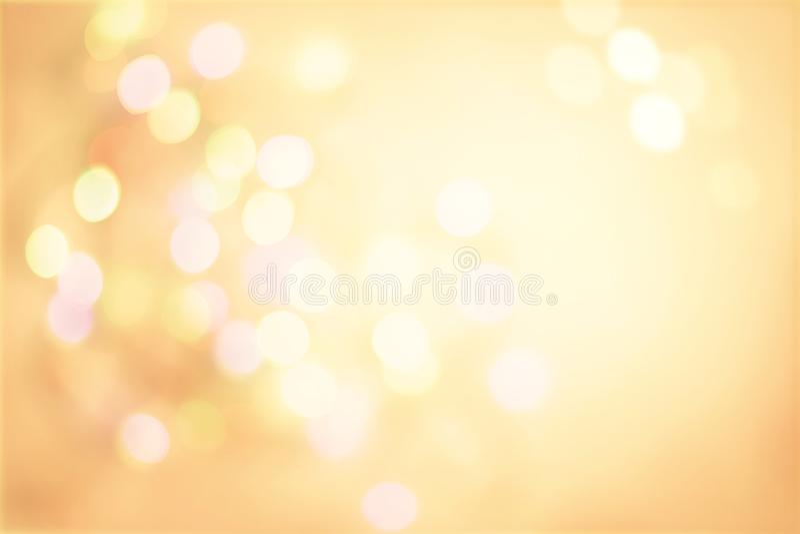 Fundo pastel do vintage do ouro com boke claro dos pontos Defocused fotos de stock royalty free