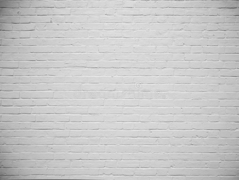 Fundo pintado branco em branco da parede de tijolo fotografia de stock royalty free