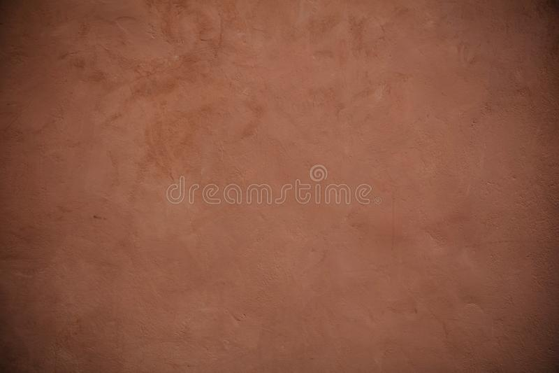 Fundo pintado estuque do grunge da textura da parede de Brown fotografia de stock royalty free
