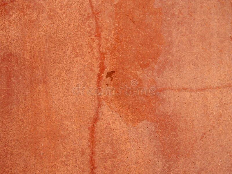 Fundo pintado textured áspero rachado vermelho desvanecido velho do muro de cimento fotos de stock