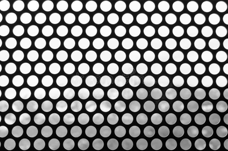 Fundo preto e branco de uma grade do manchado Teste padrão do estilo redondo do vintage dos furos Foto para o slider da site ilustração do vetor